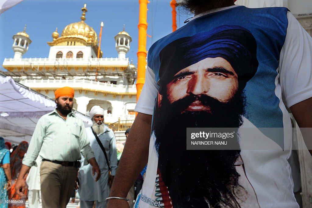 An activist from a radical Sikh wears a T-shirt depicting Sikh leader Sant Jarnail Singh Bhindranwale after prayers at Sri Akal Takht at the Golden Temple in Amritsar on June 6, 2010. 'Ghallughara Diwas' is the anniversary of the deadly 1984 Indian army 'Operation Bluestar' assault on the Golden Temple complex to arrest Sant Jarnail Singh Bhindranwale, a Sikh leader and his militant followers who had initiated a movement for a separate Sikh state.