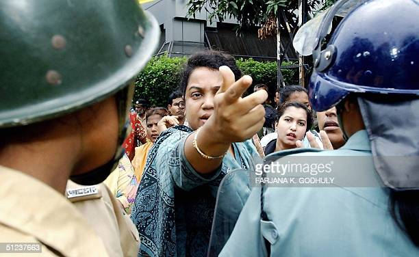 An activist from Bangladesh's main opposition party Awami League has an argument with the police during a daylong nationwide general strike in Dhaka...