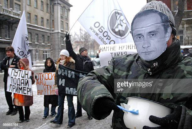 An activist from Oborona a youth group backed by the liberal Union of Right Forces and the opposition liberal Yabloko party wears a mask with the...