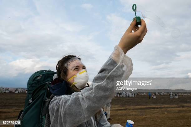 An activist from the collective Ende Gelande seen on the mine site during a demonstration ahead of COP23 As COP 23 is about to launch in Bonn the...