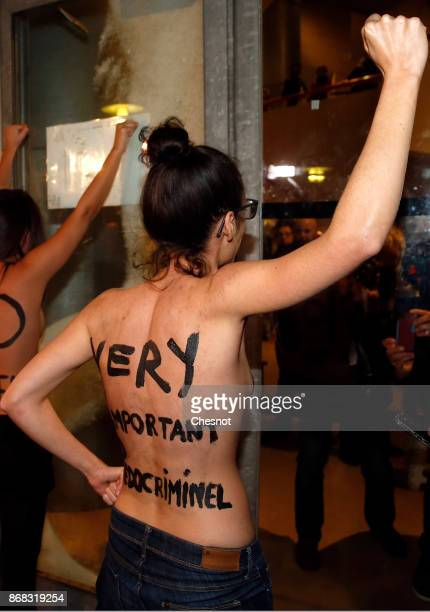 An activist from the feminist group 'Femen' with the slogan Very important pedocriminal written on her body demonstrates outside the Cinematheque...
