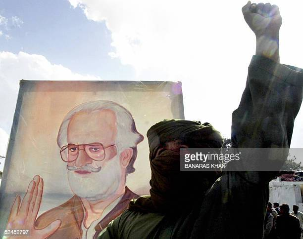 An activist from the four party alliance Pakistan Oppressed Nations Movement shoutS antigoverment slogans whilst displaying a picture of Nawab Akbar...
