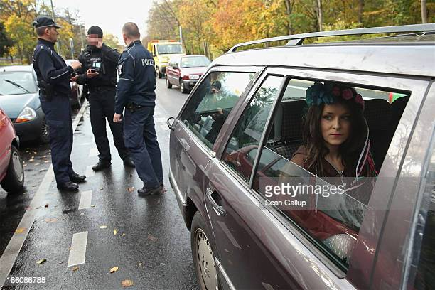 An activist from the women's rightsgroup Femen sits in a car after police stopped her and three others for protesting in an unregistered...