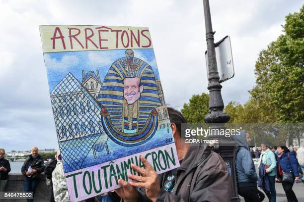 An activist holds a banner while taking part in a protest during the nationwide strike called by various French unions against proposed labour law...