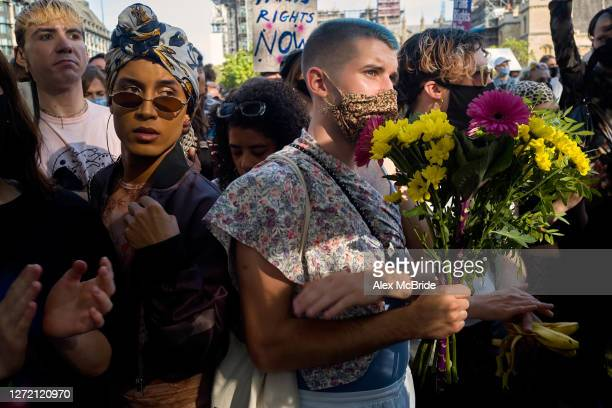 An activist holds a bouquet of flowers at a Trans Pride rally at Parliament Square on September 12 2020 in London England Protestors marched from...