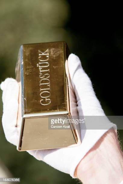 An activist holds a gold ingot during a demonstration against the increasing gap between wealth and poverty on September 29 2012 in Berlin Germany...