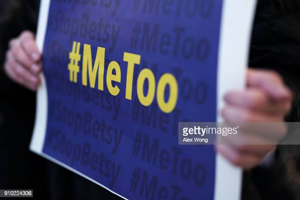 An activist holds a #MeToo sign during a news conference on a Title IX lawsuit outside the Department of Education January 25 2018 in Washington DC...