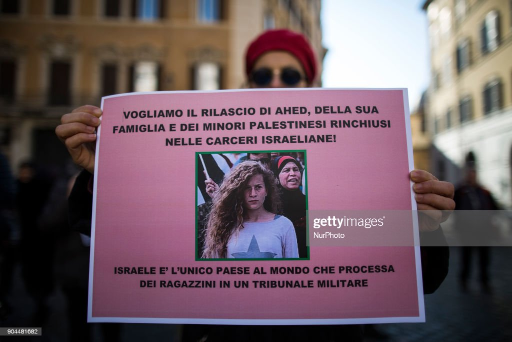 An activist holds a paper with a sign to ask the liberation of Ahed Tamimi in front of italian Parliament on January 13, 2018. A hundred of activists gathered in solidarity with Ahed Tamimi, the young Palestinian girl incarcerated in Israel since December 2017.The rally is organized by the Roman Network of Solidarity with the Palestinian People and the Palestinian Community. Ahed Tamimi is facing up to 12 years in prison over charges of assaulting Israeli soldiers, inciting and other felonies