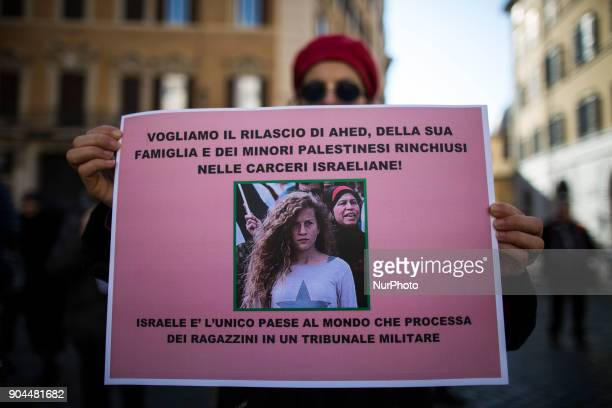 An activist holds a paper with a sign to ask the liberation of Ahed Tamimi in front of italian Parliament on January 13 2018 A hundred of activists...