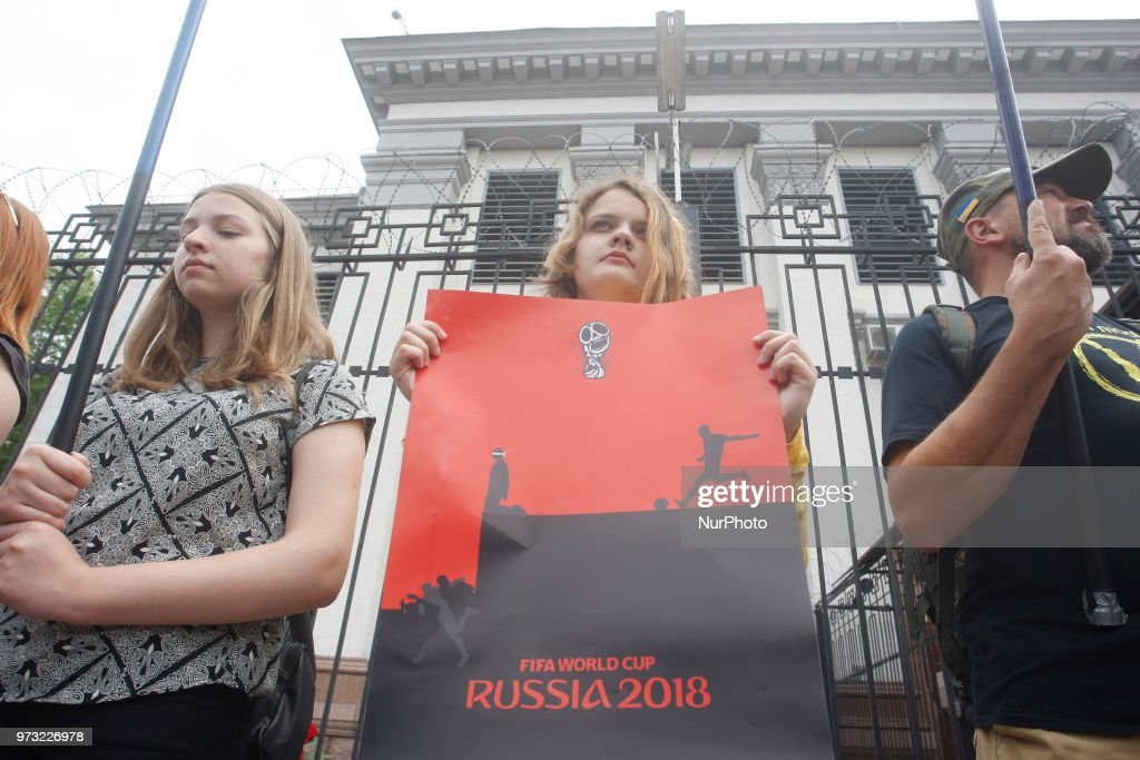 An activist holds a placard against the holding of the FIFA World Cup 2018 in Russia, during a protest for the release of Ukrainian director Oleg Sentsov and other political prisoners, near Russian Embasy in Kiev, Ukraine, 13 June 2018.