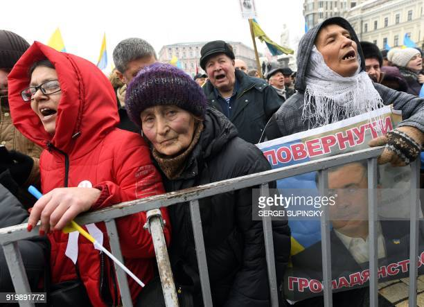 An activist holds a placard depicting former Georgian President Mikhael Saakashvili and signed 'Give back Saakashvili' during a mass march and rally...
