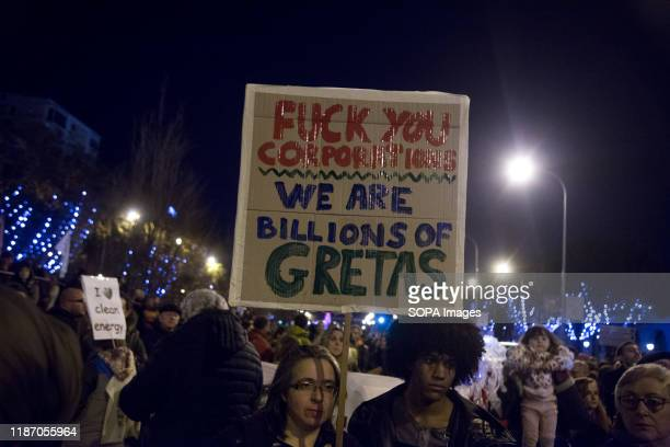 An Activist holds a placard during the demonstration. Thousands of people from all over Europe protest in Madrid against COP25, climate change and to...