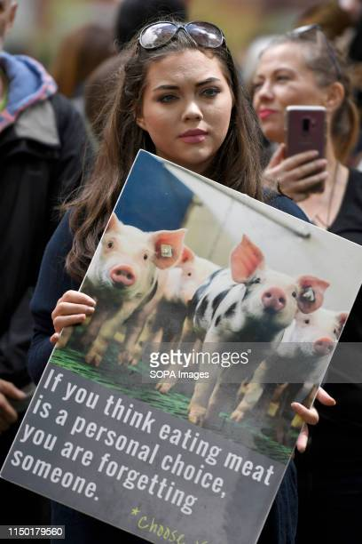 An activist holds a placard during the march Animal rights activists marched through central London to demand the closing of the slaughterhouses and...