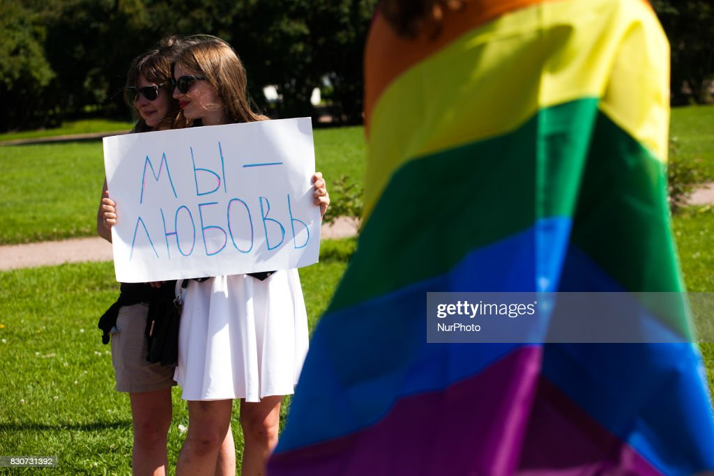 "An activist holds a placard with a slogan ""We are love"" during St Petersburg LGBT Pride on august 12, 2017"