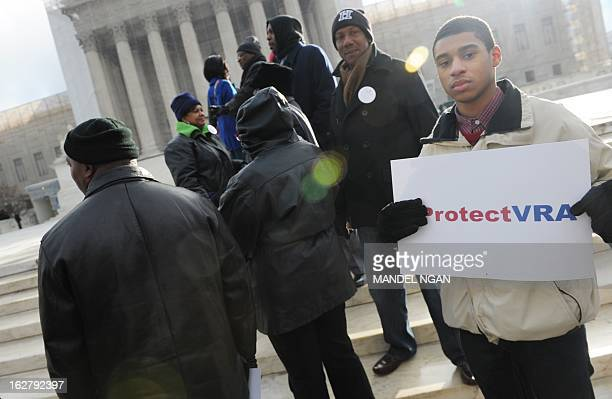 An activist holds a provoting rights placard outside of the US Supreme Court on February 27 2013 in Washington DC as the Court prepares to hear...