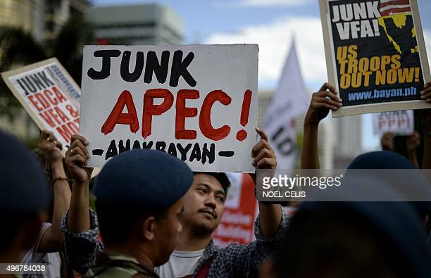 An activist holds an anti Asia-Pacific Economic Cooperation banner during a protest in front of the US embassy in Manila on November 12, 2015. The...