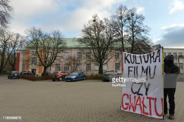 An activist holds 'Film or Rap Culture' banner during a protest in 'Solidarity Against The Rape Culture In The Film Industry' at the Polish National...