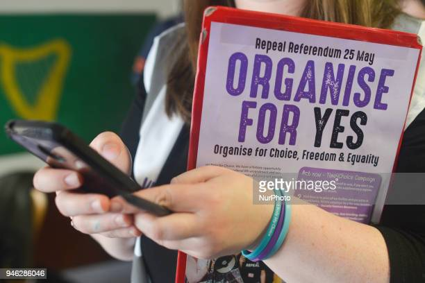 An activist holds 'Organise For Yes' leaflet during a Rally for Equality Freedom amp Choice organised by ROSA an Irish Socialist Feminist Movement at...