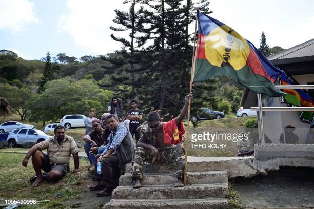 An activist holds the proindependant flag during a meeting of the Kanak and Socialist National Liberation Front campaign for a 'yes' to New...