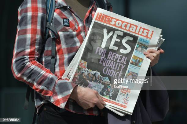 An activist holds 'The Socialist' newspaper with 'Yes for Repeal Equality Choice' written on the front page during a Rally for Equality Freedom amp...