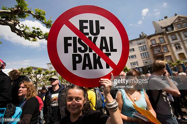 An activist holds up a sign during the Blockupy protests on May 17 2012 in Frankfurt Germany Organizers have called on tens of thousands of activists...