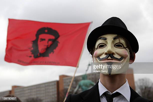 An activist in a Guy Fawkes mask protests during a demonstration against the AntiCounterfeiting Trade Agreement on February 25 2012 in Berlin Germany...