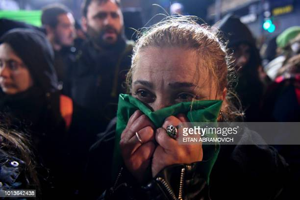 An activist in favour of the legalization of abortion reacts outside the National Congress in Buenos Aires on August 9 2018 after senators rejected...