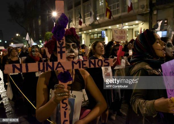 An activist madeup as 'Catrina' participates in a demonstration against feminicide on the eve of the Day od the Dead celebrations in Mexico City...