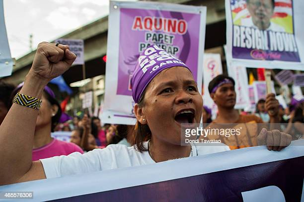 An Activist marches during a International Women's Day protest rally on March 8 2015 in Manila Philippines Various women's groups are calling for the...