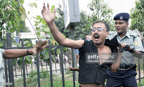 An activist of Bangladesh's main opposition party the Awami League shouts for help as police try to arrest him during the two day nationwide general...