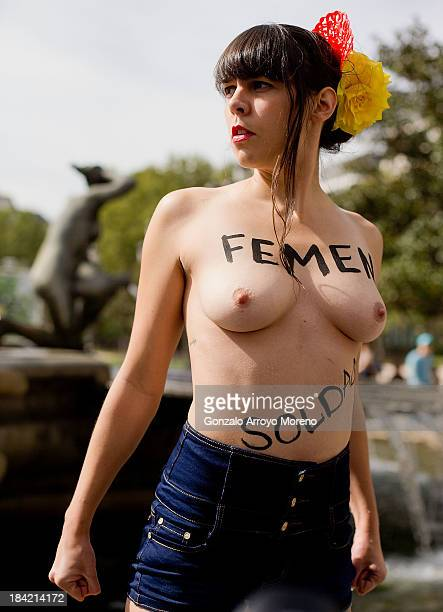an activist of feminist group FEMEN protests with her chest naked and signed with the word 'Soldier' in Spanish at Spain Square during their official...
