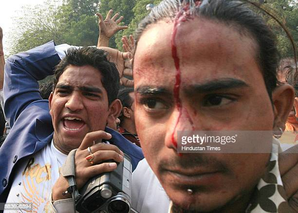 An activist of Hindu nationalist Shiv Sena party With hand disrupts a gathering of Muslims protesting against the 1992 destruction of the 16thcentury...