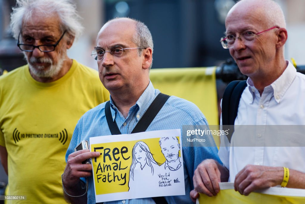 """An activist of human rights organization Amnesty International holds a placard with a sketch of Amal Fathy and Giulio Regeni and saying """"Free Amal Fathy"""" in front of Palazzo Montecitorio, the Italian Parliament, during a demonstration to call for the release of Amal Fathy, Egyptian activist and wife of Mohamed Lotfy, director of the Egyptian Commission for Rights and Freedoms (ECRF) and Regenis family lawyer in Egypt, in Rome, Italy, on September 12, 2018. On May 9, 2018, Amal Fathy posted a video on her Facebook page denouncing sexual harassment in Egypt and criticising the governments failure to protect women; Egyptian police forces arrested Fathy on May 11, 2018, with the accusations of publishing a video calling for the overthrow of the regime, spreading false news that harms national security, and misuse of the internet. Giulio Regeni was an Italian Cambridge University graduate who was abducted and tortured to death in Egypt in 2016, sparking global outrage and a diplomatic crisis between Italian and Egyptian governments. SPATARI"""