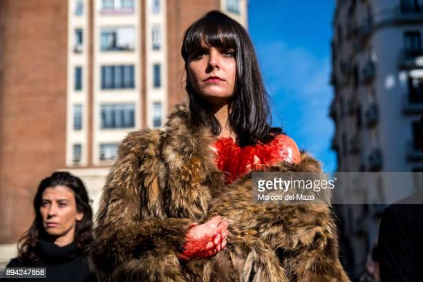 An activist of proanimal rights group 'Anima Naturalis' performing a protest covered with fake blood and animal skin coat to protest against the use...