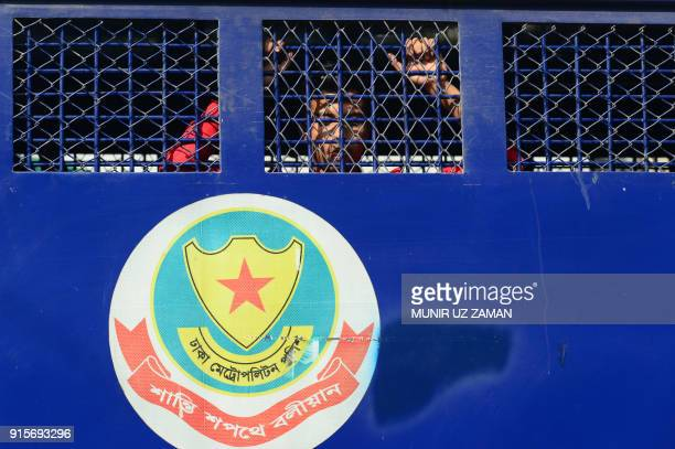 TOPSHOT An activist of the Bangladesh Nationalist Party looks out from a prison van after he was detained by police ahead of a verdict in the...