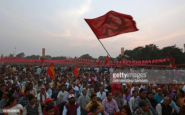 An activist of the Communists Party of india Marxist waves a party flag during a mass rally in Kolkata on December 6 to mark the 21st anniversary of...
