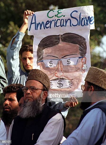 An activist of the Jama''atiIslami party displays a banner as Munawar Hassan acting chief of the JI party speaks at a rally November 16 2001 in...