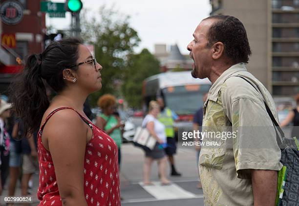 An activist of the National Queer Asian Pacific Islander Alliance and KhushDC stands by as a passerby reacts, during a rally in Washington, DC, on...