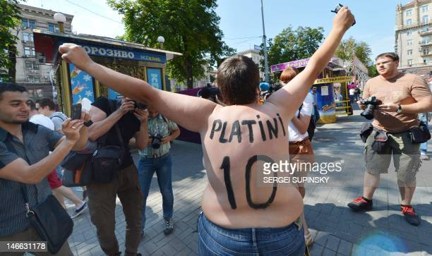 An activist of Ukrainian women movement Femen protests in the Euro 2012 fanzone in Kiev on June 21 2012 during the Euro 2012 football championships...