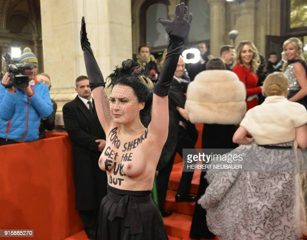 An activist of women's rights movement Femen demonstrates on the red carpet prior the opening of the Opera Ball 2018 the sumptuous highlight of the...