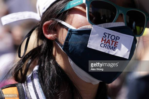 """An activist participates in a """"DC Rally for Collective Safety - Protect Asian/AAPI Communities,"""" hosted by OCA – Asian Pacific American Advocates, at..."""