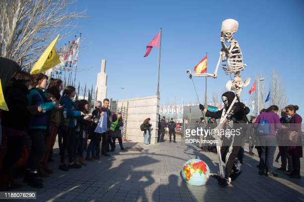 An activist performs Death hits the Earth during the demonstration. There was a spontaneous saucepan protest at the entrance of COP25 where climate...