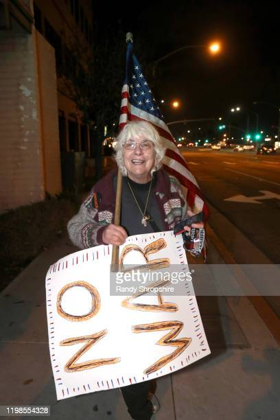 An activist rallies at the intersection of 14th Street and Lime for No War in Iran demonstration on January 09 2020 in Riverside California