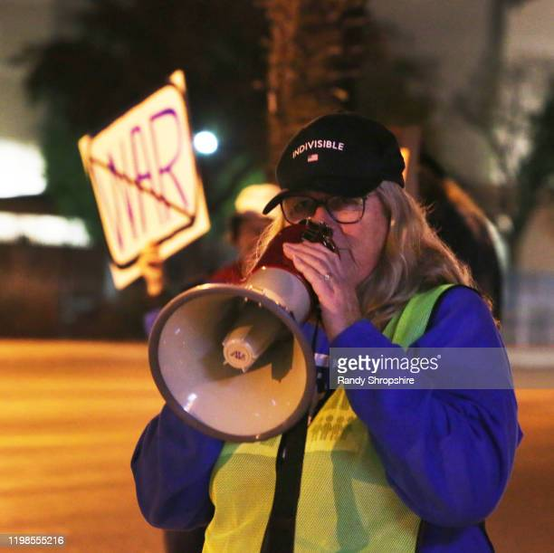 An activist rallies at the intersection of 14th Street and Lime for No War in Iran on January 09 2020 in Riverside California
