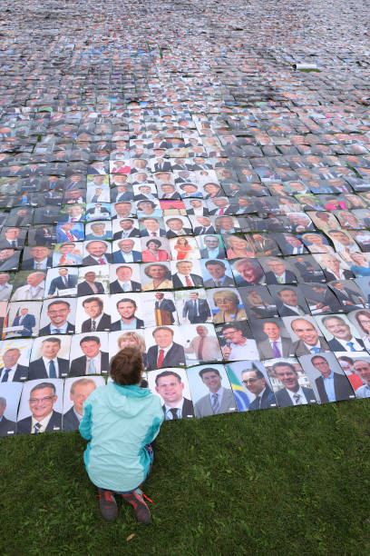 DEU: Activists Create Mosaic of 48,000 Photos To Protest For Human Rights
