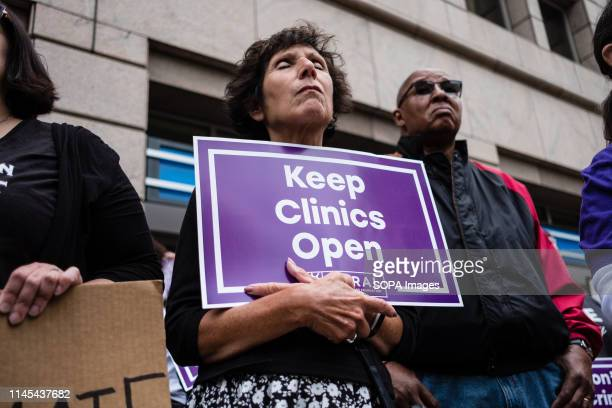 An activist seen holding a placard that says keep clinics open during the protest Abortion rights activists took part in stop the bans rally...