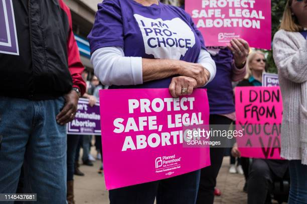 An activist seen holding a placard that says protect safe legal abortion during the protest Abortion rights activists took part in stop the bans...