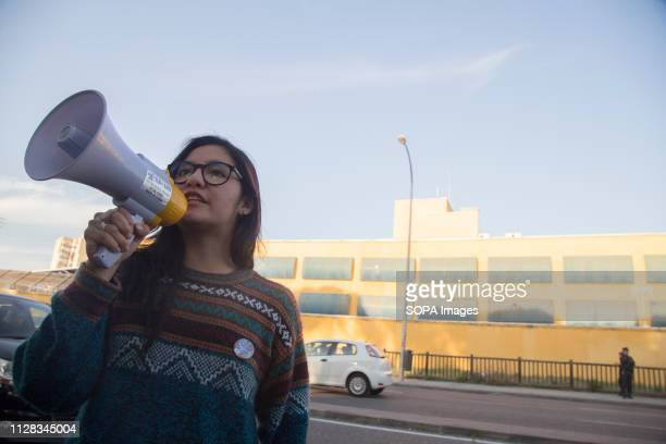 An activist seen speaking on a megaphone during the protest Feminist movement protest as a preparatory action for the March 8 feminist strike in...