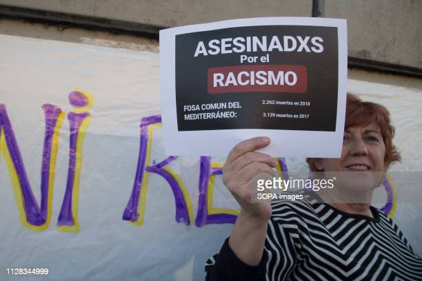 An activist seen with a placard in memory of the immigrants killed during the protest Feminist movement protest as a preparatory action for the March...