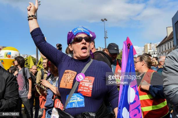 An activist shout slogans as she take part in a protest during the nationwide strike called by various French unions against proposed labour law...
